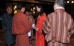 After their hike, the royal attended a reception celebrating Britain's relationship with Bhutan. Kate wore a dress by Beulah, that featured poppies the national flower of Bhutan.