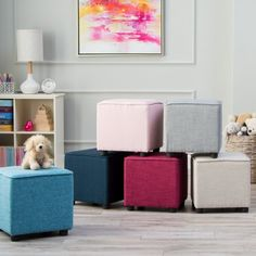 The Classic Playtime Hannah Upholstered Cube Ottoman Seat is a smaller.