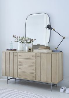 The grooved doors of Loaf's wooden Nickle sideboard give a hearty and satisfying clunk as they close. The Clunk of Quality as we like to call it. This modern design is handmade in raw oak with sleek vintage-style steel legs and lots of handy storage.