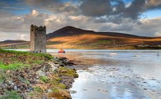 (Caisleán Grace ar) Grace O'Malley's  (Grainne Uaile) Castle in Mayo, Ireland.    This goes on my list of places to see, but not just because of the famed pirate queen.  This castle is the setting in Derek Gunn's The Estuary, where survivors must make a last stand against the undead.