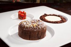 Chocolate fondant with white chocolate mousse and strawberry & mint tartare with cocoa streusel