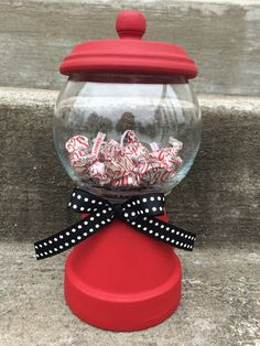 Faux Gumball Machine. This is made with 4 terra cotta clay pot, glass rose bowl and terra cotta lid. Fun gift for any Teacher. Fill will