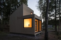 This Norwegian cabin features picturesque views of a small lake and surrounding forest. Woody15 | Marianne Borge / photos Jonas Adolfson | Tiny Homes