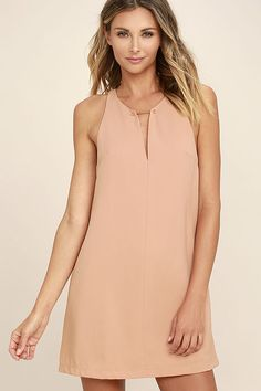 Lulus Exclusive! Wear the Near or Bar Blush Shift Dress here, there, and everywhere in between! Lightweight woven fabric is perfectly breezy across a sleeveless bodice with a deep V-neck that is joined by a shiny gold bar. Side darting tops the shift silhouette. Back keyhole with top button.