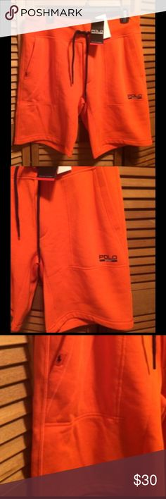 Ralph Lauren Orange Shorts Orange shorts with deep pockets with Polo Sports on one pocket and black Polo logo on the right pocket, with stretch waistband with black draw string. Size Medium. 91% polyester 9% cotton. NWT Polo by Ralph Lauren Shorts Athletic