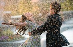Dancing in the rain, head thrown back