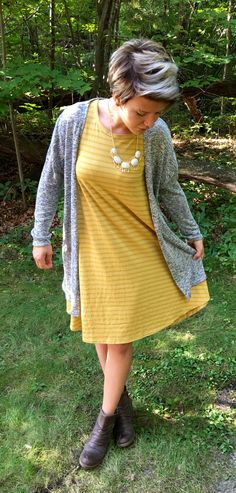 LuLaRoe Carly swing dress with short boots and a fun necklace. Here it's…