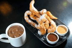 Churros and Chocolate, Spain As if the sugar-coated, crispy pastry deliciousness of a Spanish churro weren't enough, try dunking the fried . Steaming Cup, Bowl Of Cereal, Chocolate Coffee, Scrambled Eggs, Beignets, International Recipes, Burritos, Espresso, Food Photography