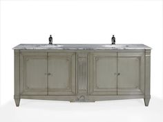 Bespoke Addicot vanity unit in French Cherry and Lamartine Grey finish with details in Silver Leaf and Pele de Tigre marble top. http://www.oficinainglesa.com/en/french_catalogue/storage/vanity_units/addicott-1820 #oficinainglesa #frenchbathroom