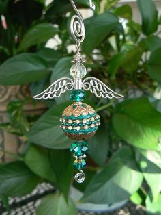 Arabic-inspired beaded green hanging angel by LindaGillottiDesigns on Etsy