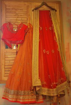 Madsam Tinzin Orange #Lehenga With Red Blouse & Yellow Border.