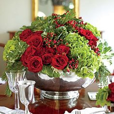 Pair velvety red with chartreuse green to give the classic Christmas colors a fresh update. Start with a silver punch bowl. Round shapes work best here. Christmas Flower Arrangements, Christmas Table Centerpieces, Christmas Flowers, Christmas Tablescapes, Floral Centerpieces, Christmas Colors, Floral Arrangements, Christmas Holidays, Christmas Wreaths