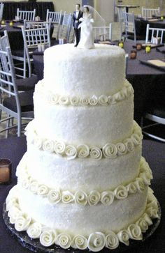 Vintage themed wedding cake with fondant rolled roses