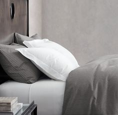 RH's Garment-Dyed Ticking Stripe Bedding Collection:Inspired by classic ticking-stripe fabric, our bedding is woven from yarn-dyed cotton for authenticity and washed for heirloom softness. California artisans at Matteo tailor the collection from the original black-and-white fabric, then garment-dye the pieces in small batches to produce a vintage over-dyed look. A final wash enhances the fabric's naturally smooth feel and drape. Designed to coordinate with every piece in our Bespoke Garm...