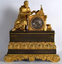 19TH CENTURY FRENCH ORMOLU AND BRONZE MANTEL CLOCK modelled as a seated scholar with his hand resting upon the top of the dial. 1Ft 4.5ins high.