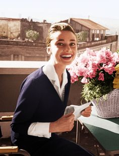 Audrey Hepburn on the terrace of the Hotel Hassler, in Rome, with the telegram announcing her best-actress award, for The Nun's Story, from...