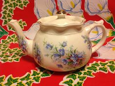 This vintage Arthur Wood and Son porcelain teapot has a beautiful violet floral design. it measures 4.5 tall. it is marked Arthur Wood and Son,
