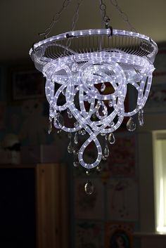 """3 easy DIY home lighting projects. A fun and cheap way to """"remodel"""" your home on a budget. Rope light chandelier, DIY canvas light, and a LED strip light floating mirror!"""