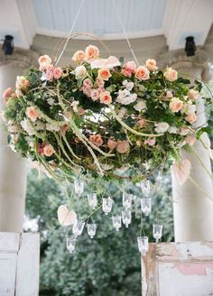 For a garden wedding - a floral chandelier with hanging tea lights ~ http://www.colincowieweddings.com/inspiration-and-details/10-totally-gorgeous-garden-wedding-ideas