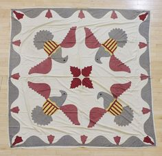 Pennsylvania appliquéd quilt top, 19th c., with applied eagle decoration, 78 x 82 inches.