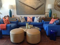 Midnight #blue #upholstered #sofa and bright #toss #pillows vignette with #nailhead detailing #ottomans at #Hamptons #MecoxGardens #furniture #shopping #home #decor #design #room #designidea #vintage #antiques #garden
