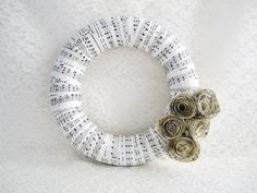 vintage music paper wreath...i love this.  i have an old baptist hymnal that would love to be made into a wreath.