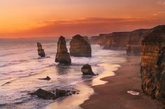 The Apostles - Pinned by Mak Khalaf Nikon d7000 16-85 vr Beautiful sunset over 12 Apostel durin my travel in the Great Ocean Road Landscapes australiabeachbluecloudscoastoceanrockssandseaseascapeskysunsettravelwaterwaves by mazzocatonicola