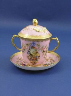 Coalport cup and cover, on stand