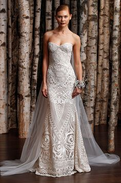 This strapless wedding dress by Naeem Khan has incredible embroidery details.
