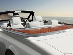 2013 Rolls Royce Phantom Drophead Coupe with teak. We at IndusParquet love this luxury living.