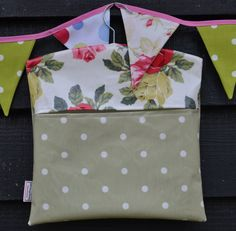 Gorgeous handmade oil cloth peg bag in a spotty green and pretty floral rose.