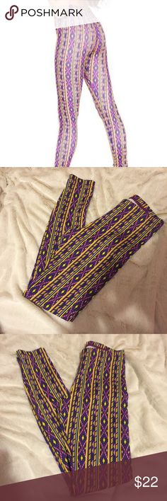 American Apparel Purple Aztec Print  Nylon Legging American Apparel Snake Aztec Print Nylon Leggings. Purple Pattern with yellow. excellent condition.Reasonable Offers Accepted.  Size: Medium American Apparel Pants Leggings