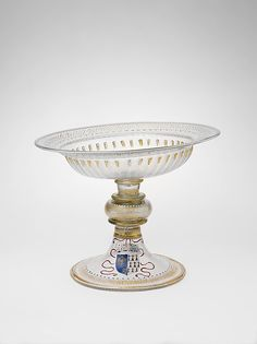 Artist:Italian (Venice) or façon de Venise (Venetian-style) Artist: Possibly French Date:1499–1514 Culture:Venetian or façon de Venise, or French Medium:Colorless (slightly gray) nonlead glass; blown, pattern-molded, enameled, gilt Dimensions:8 11/16 in. (22.1 cm); diam. of rim 10 7/8 in. (27.6 cm)
