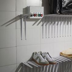 ::RETAIL:: Martin Margiela store in Munich. Shelving hardware creates the shelving itself--nice.