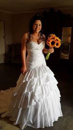 beautiful plus size wedding dress...with less ruffles on bottom though