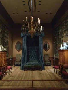 Walking into this room would make me think to myself...what is about to happen to me? --Mysterious gothic style bedroom -- I like