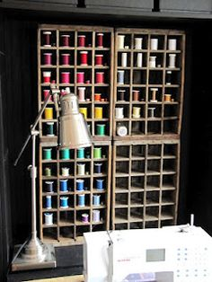 Great way to display/organize thread...use old wooden soda crate. This would be nice if I had a dedicated sewing/crafting room.