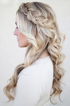 Long braided wedding hair with loose curls.