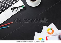 Office leather desk table with laptop, coffee cup, notepad and reports. Top view with copy space