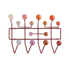 As an alternative to simple hooks, this wardrobe's brightly coloured wooden spheres are meant to encourage children to literally hang up all their things.Hang It All, designed by Charles Eames in 1953 and manufactured today by Vitra can be extended as required and is a cheerful alternative to boring clothes hooks, not only for children's rooms.Contact us now for help, for a personalised quote and to discuss savings for trade and volume purchases
