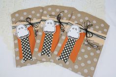 This listing is for a set of 3 decorated kraft paper gift bags. These are done up for you in a Halloween theme perfect for many goodies. All