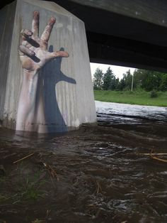 Amazing 3D street art - Can barely tell that's not an actual hand reaching out of the ground!