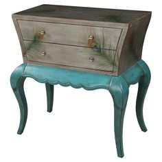 Accent chest with cabriole legs and a glittering peacock feather motif. Product: ChestConstruction Material: WoodColor: Gray and turquoiseFeatures: Peacock-inspired designDimensions: 31 H x 31 W x 17 D Cool Furniture, Painted Furniture, Studio Furniture, Distressed Furniture, Outdoor Furniture, In Vino Veritas, My New Room, Joss And Main, Decoration