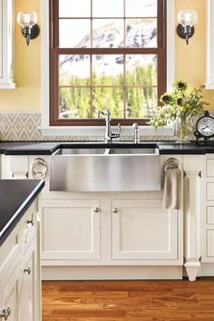 Pro-style, 18-gauge stainless steel gives this bowed apron-front sink a sharp look. It's a pot-accommodating 9 inches deep and comes with a single or double basin. From moen.com |  thisoldhouse.com