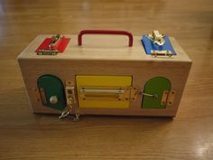 Montessori Materials 12 months and up.  This lock box provided endless minutes of concentration and hand strengthening.