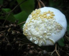 cream & yellow embroidered button