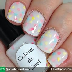 "By @coloresdecarol ""Circus"" is a white crelly base with micro holographic glitter, matte yellow triangles, matte watermelon hexagons and matte light blue mini stars. Super cute! I used three thin coats and glitter placement in between the layers.  Use code MELISSA at checkout and save 10% on your order!"