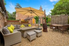 All day sun trap, south facing patio, outdoor entertainment, outdoor living, country living Exposed Brick Walls, Exposed Beams, Country Life, Country Living, Grey Painted Walls, Log Burning Stoves, Window Seat Storage, Multi Fuel Stove, Paved Patio