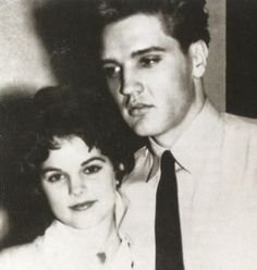 Priscilla and Elvis' last night together in Germany. They look so sad.