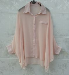 Sheer pink shirt. The pocket has to go.